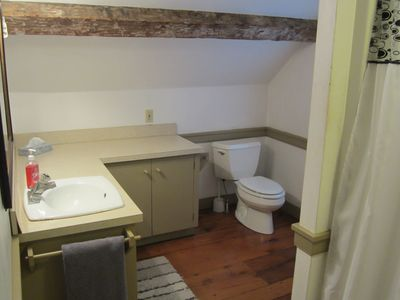 Bathroom featuring the beautiful hardwood floors found through out the house..