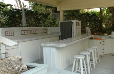 Boathouse complete with wet bar is ready for outside entertaining.