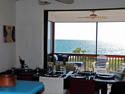 Dining Area Opens to Screen Room,  Catch the Gulf Breezes.