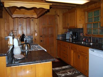 Remodeled kitchen w/ granite counter & stocked w/ appliances, for the home-chef!