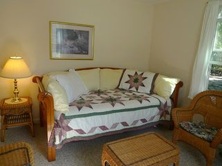 Dennisport house photo - The cozy family room has a daybed, wicker love seat and chairs.