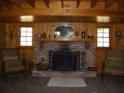 Rustic fireplace and knotty pine interior provide a warm & cozy place to relax