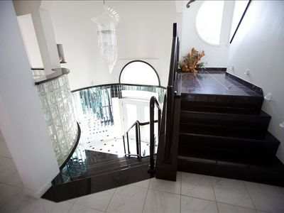 Front Doors with Mirrored Foyer including Granite staircases to 2nd & 3rd floors