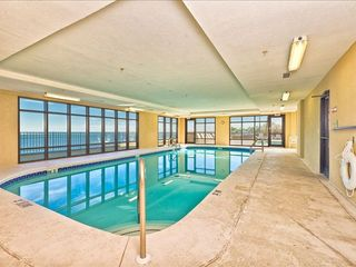 Large indoor pool with wall of windows overlooking Perdido Pass and pool