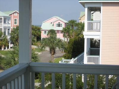 View from deck of rental home, looking toward oceanfront pink home