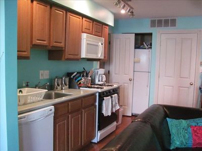 galley kitchen is fully equipped, with added pantry
