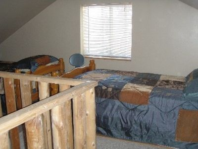 Two twin beds and one futon in upper level loft
