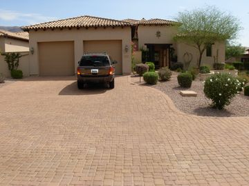 Paver Driveway and 2 car garage.