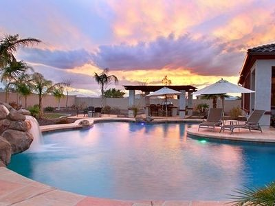 Backyard resort area with palm trees, fire pits, water fall, and 1200 sq ft pool