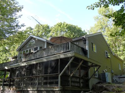 Moultonborough house rental - Pedrovilla back of the house with deck above and screened room below