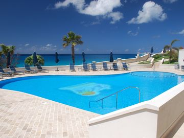 Meticulously maintained and large, outdoor sculptured pool with lounge chairs