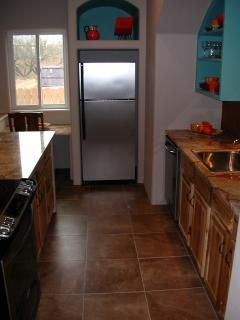 Kitchen aisle. Microwave unit is behind cabinet door.