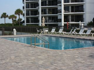 New Smyrna Beach townhome photo - Pool area. Approximately 150-200 feet from the condo.