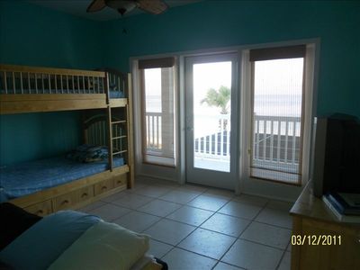 Spacious kids room with bunk beds, futon, TV and balcony.