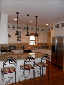 View of the kitchen - granite countertops, gas stove and oven, big sink