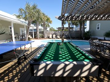 Pool Area with Ping Pong, Pool Table, lots of seating and palm trees
