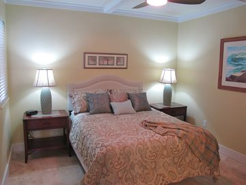 Main level queen bdrm w flat screen TV, window, art, & private access to bthrm.