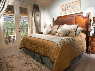 Formosa Gardens villa photo - The Blenheim Suite with Doors to Balcony Area overlooking pool & lake