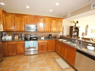 Gourmet kitchen: stainless, hardwood, granite and tile floors - Roatan villa vacation rental photo