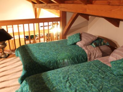Loft area with two twin beds. This area is open and accessible by ladder only
