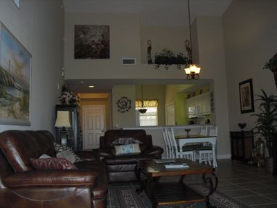 Spacious living area with vaulted ceilings.