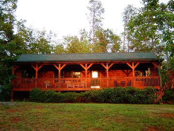 Lake Lure cabin rental - See the American Flag flying above Chimney Rock