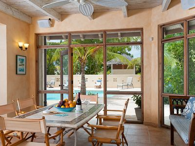 The pool porch is another dining area adjacent to the kitchen.