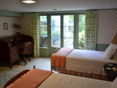 The fourth bedroom in the main house with a small terrace and outdoor shower.