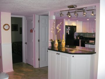Side Bar adjacent to Kitchen