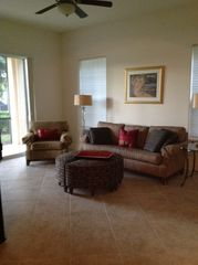 Fiddlers Creek condo photo - sitting/TV area off kitchen, lanai on left