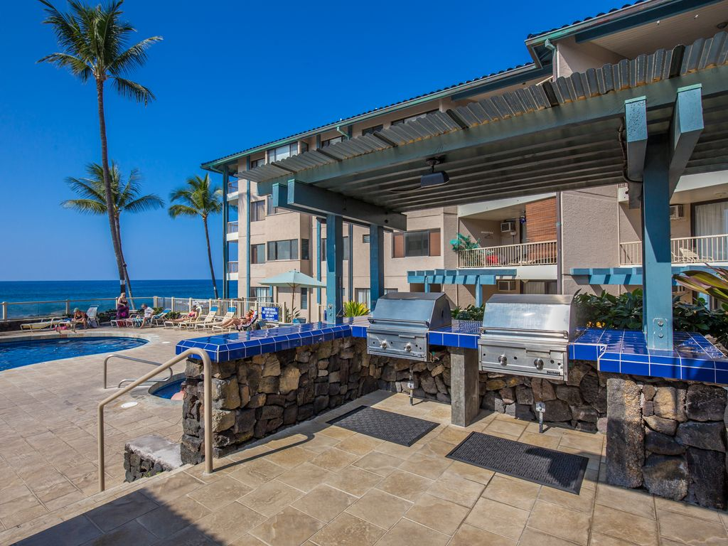 4 gas grills by the pool