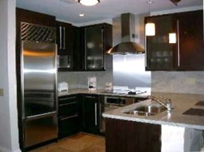 Kitchen with all upgraded appliances and custom cabinetry.