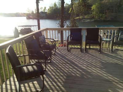 Enjoy the lake view from the outdoor upper deck.