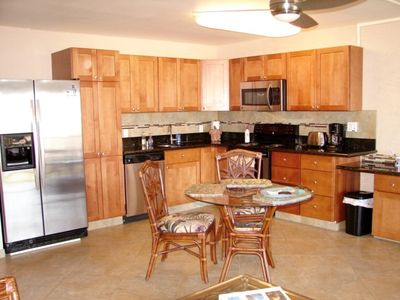 Spacious kitchen with granite counter tops and stainless steel appliances