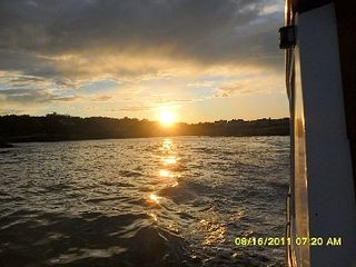 Wells cottage photo - View of sunset over the Ocean from a boat ride