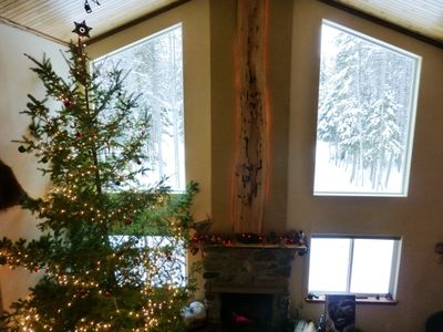 Looking out the large, great room windows towards the snow clad trees.