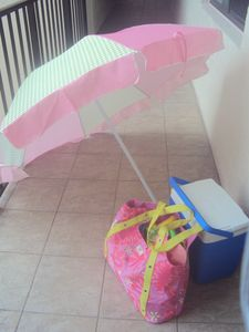 Umbrella, Beach Bag and cooler are provided
