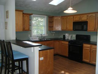 Saunderstown house photo - Large kitchen with gas stove
