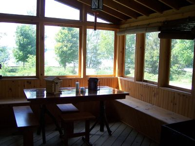screened porch with a view of the lake
