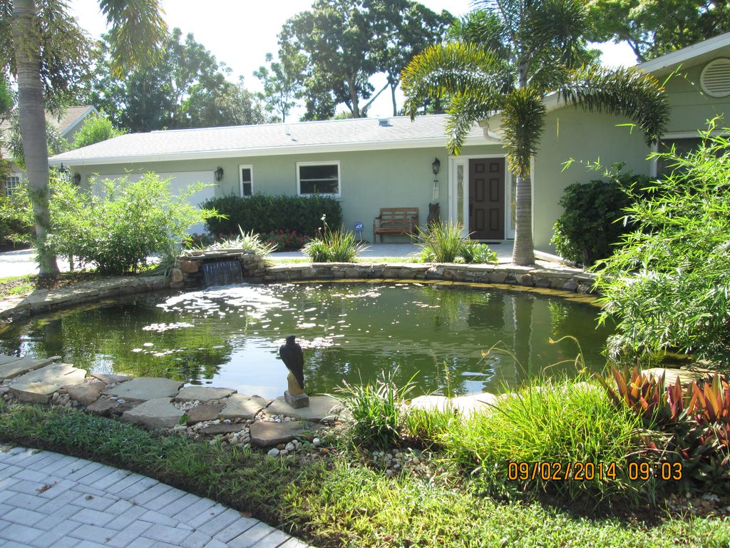 Tranquil private pet friendly fenced in vrbo for Koi pond next to pool