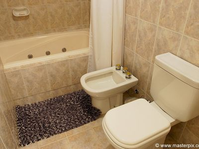 Master bathroom upstairs has a Toilet, Bidet and shower with Jacuzzi bathtub.