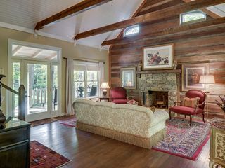 Franklin house photo - Great room with hand laid fireplace made with stones from the land