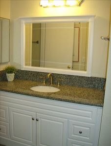We have completely remodeled our condo w/granite counter tops in the bathroom!