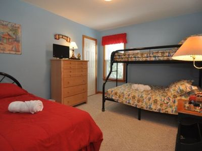 Mid Level Bedroom w/twin bed and duo bunk, shared bath.