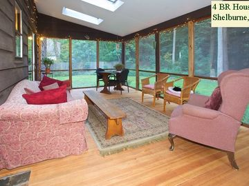 SCREENED-IN PORCH: faces back yard and the woods beyond. Perfect place to relax.