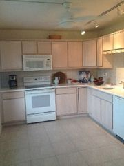 Sanibel Island condo photo - Fully equipped kitchen with large desk/work area overlooking the gardens!