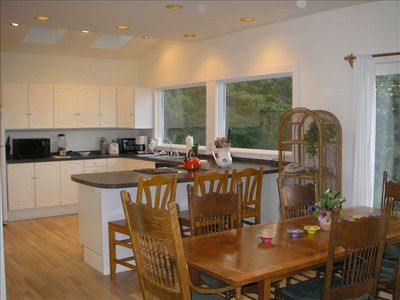 Spacious kitchen overlooks the dining room with fireplace - Dine fireside