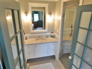 Edgartown house photo - French Doors Open To Master Bath With Marble Vanity & Handcrafted Walk-in Steam Shower