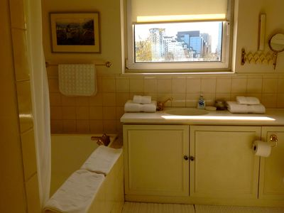 Top floor en-suite with large bath, overhead shower, bidet, WC, marbled vanity.