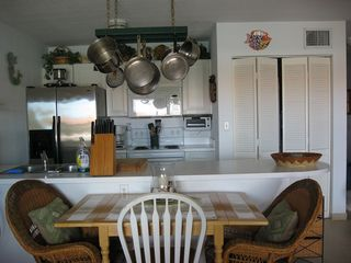 Gourmet kitchen, filtered water & ice in refrigerator door - Bimini condo vacation rental photo